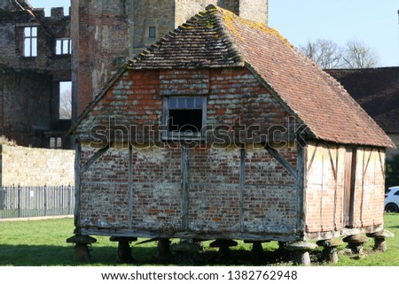 Old brick barn granary supported by staddle stones #1382762948