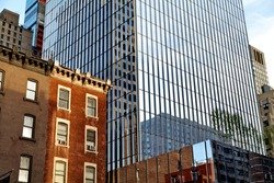 Old brick building and modern glass tower. New York.  United States.