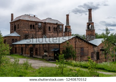 Old brick building with blast furnace from an old closed down steel mill or ironworks in Sweden #1240870552
