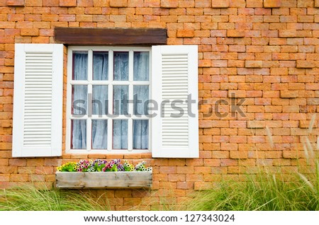 Old Brick Building with vintage and European style with flower porch in the front