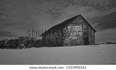 Old Brick House in Snowy Landscape After a Blizzard