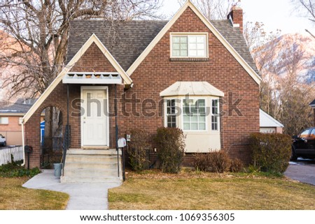 Old brick house with multiple entrances