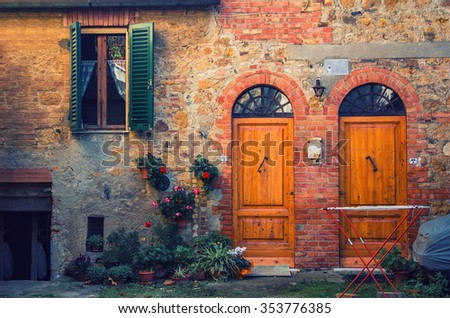 old brick italian facade stylized vintage hipster with two doors and a window