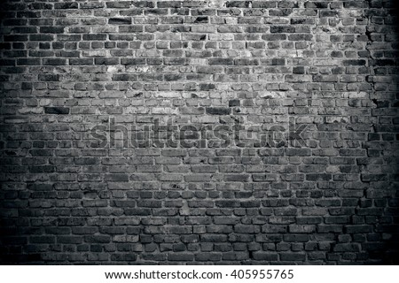 Old brick wall background. Grunge texture. Black wallpaper. Dark surface