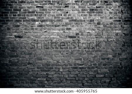Old brick wall background. Grunge texture. Black wallpaper. Dark surface