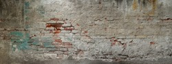 Old brick wall banner. Painted Distressed Wall Surface. Grungy texture. Grunge wall background. Building facade with damaged plaster.