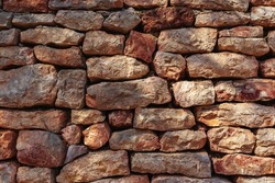 Old brick wall in a summer day. Abstract decorative background or art texture. Copy space.