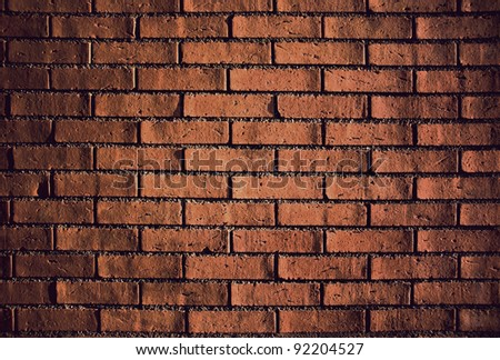 Old brick wall in evening light, emphasizing the texture.