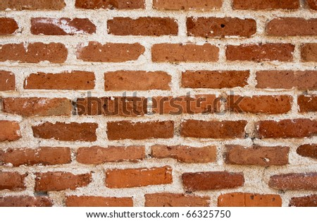 Old brick wall in the street of Madrid