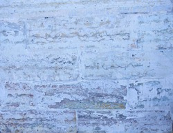 old brick wall of white, gray colors. Cement, brick. Textured background, uneven, rough surface, vintage. Finishing work