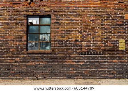 Old brick wall with brick filled window. #605144789