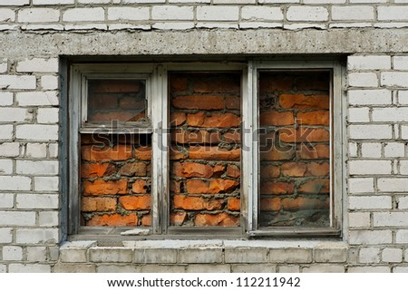 Old brick wall with immured window