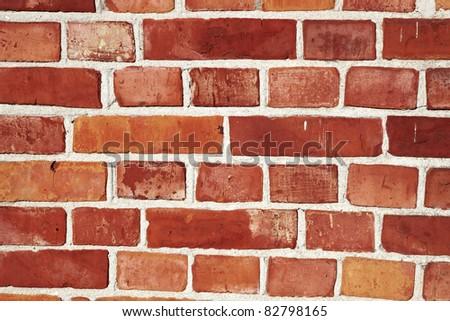 Old brick wall with orange red bricks - stock photo