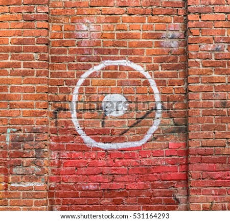 Old brick wall with painted target #531164293