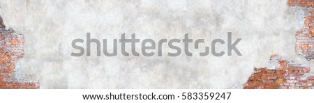 Old brick wall with peeling plaster, grunge background #583359247