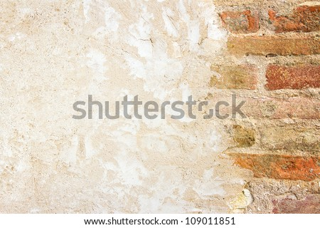 Old brickwall and plastered wall with copy space - stock photo