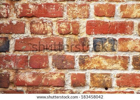 Old brickwall of yellow and red brick, texture