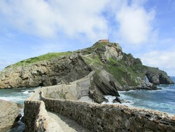 Old bridge and stairway to rock and church of San Juan de Gaztelugatxe, Basque Country, Spain