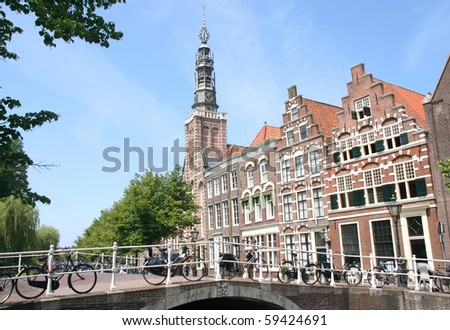 Old bridge, church and historic houses in Leiden, Holland