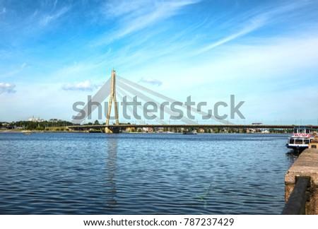 Old bridge in the European city of Riga. #787237429