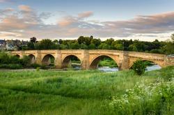 Old Bridge over the River Tyne at Sunset. Corbridge, England,