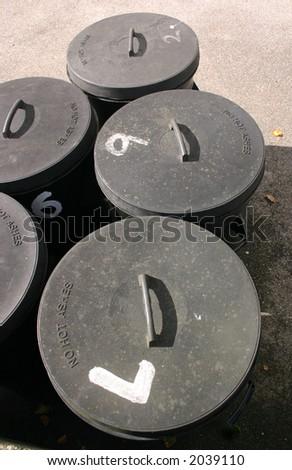 Old British plastic black bins