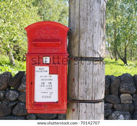 Old British Post box supported on a wooden telegraph pole
