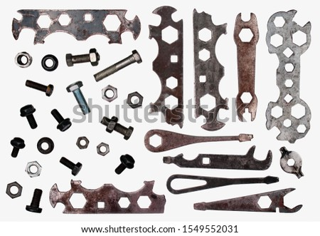 Old broken bicycle tools in a workshop. Spanners, screwdrivers, nuts and bolts isolated on white background. #1549552031
