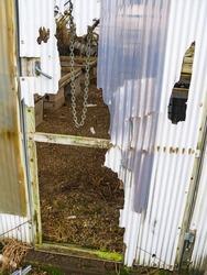 Old broken door to a greenhouse