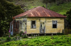 Old broken  down house with colorful walls, Coromandel New Zealand