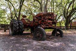 Old broken down red tractor