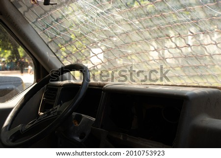 old broken military vehicle with bars on the front window, the car after the passage of hostilities, auto Foto stock ©