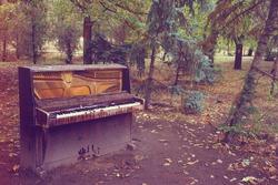 old broken piano stay outdoor