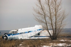 Old broken plane on an abandoned airfield in Russia