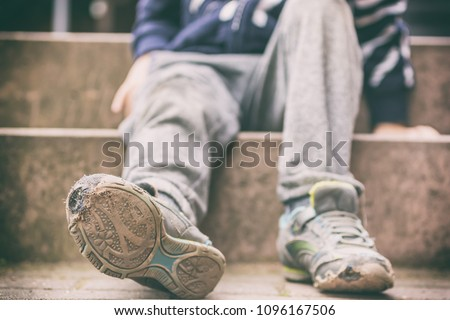 Old broken shoes of a little boy as a symbol for child poverty Сток-фото ©