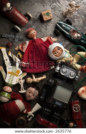 http://image.shutterstock.com/display_pic_with_logo/54791/54791,1170879231,1/stock-photo-old-broken-toys-on-the-floor-2635776.jpg