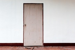 Old broken white door and wall with space