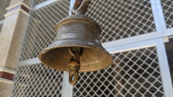 Old bronze bell in indian temple with blur background. Hindu temple brass bell hanging in gold color
