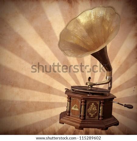 Old bronze gramophone on vintage background #115289602