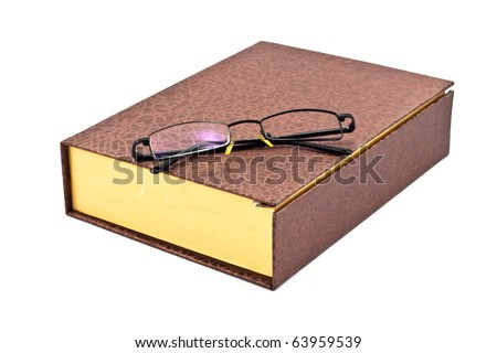 old brown book and single len eyeglass  isolated on a white background - stock photo