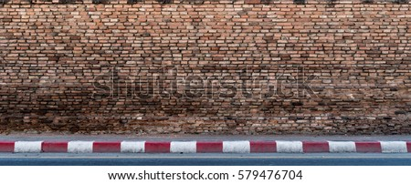 old brown brick wall with...