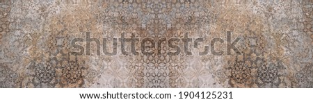 Old brown gray rusty vintage worn shabby patchwork motif tiles stone concrete cement wall texture background banner panorama Stock photo ©