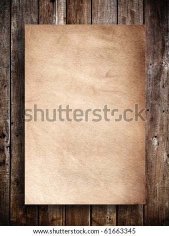 Old brown paper on wood panel