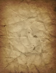 Old brown paper parchment background design with distressed vintage stains and ink spatter and crumpled wrinkled creases and faded tan center, elegant antique beige color