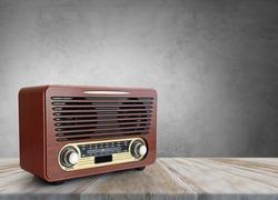 Old brown radio, retro radio on wooden table. Perspective vintage radio.