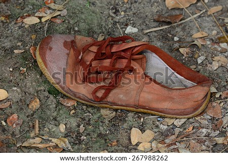 old brown shoes that were left on the dirty floor