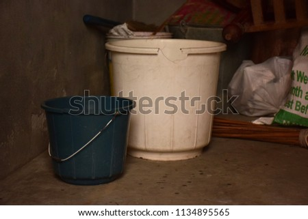 Old buckets kept inside store room