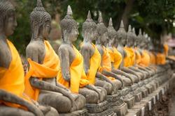old Buddha statue in temple at Wat Yai Chai Mongkol at Ayutthaya, Thailand. World Heritage Site