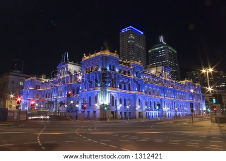 old building in brisbane colourfully illuminated at night