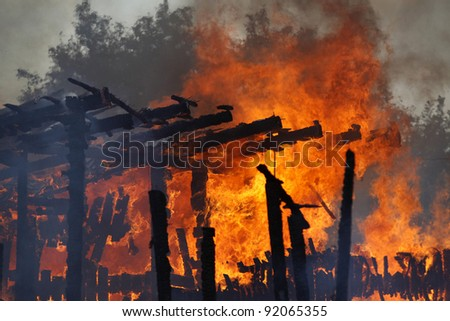 Old building in full flaming - stock photo